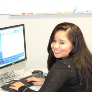 Yihra Perlata in front of computer