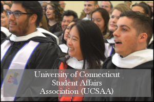 Three HESA students at graduation, laughing.  Text includes: University of Connecticut Student Affairs Association (UCSAA)