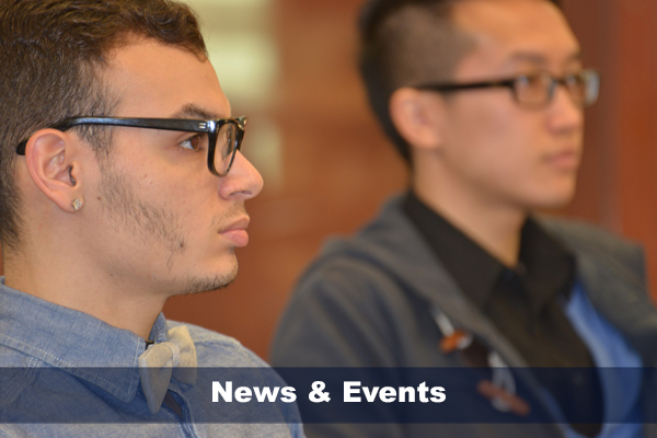 Two male students engaged in listening during a HESA class.  Text on photo reads: NEWS & EVENTS