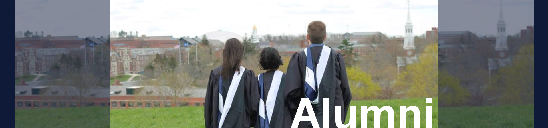3 recent graduates looking over campus from atop a hill